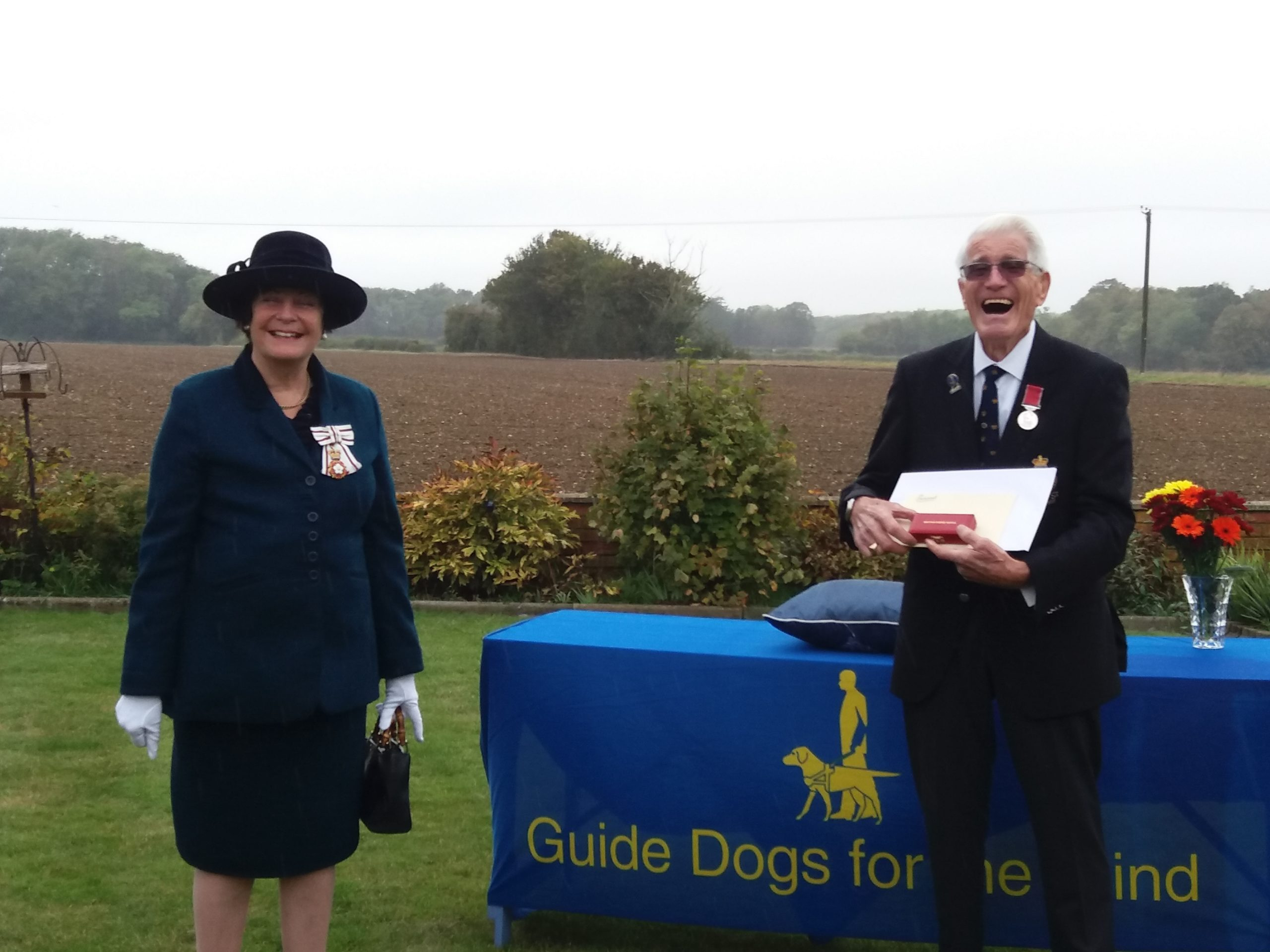 Mr Bryan Garnham collecting his award